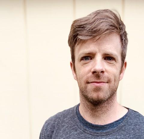 A headshot of playwright Jake Jeppson.