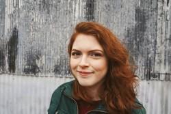 A headshot of Playwrights' Center Development Assistant Teri Teri Schafer. She's wearing a green top.